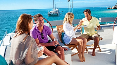 Couples sailing on private boat charter from Cairns